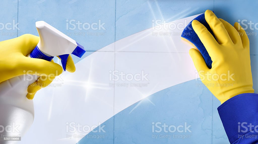 Employee professional cleaning with gloves and scourer stock photo
