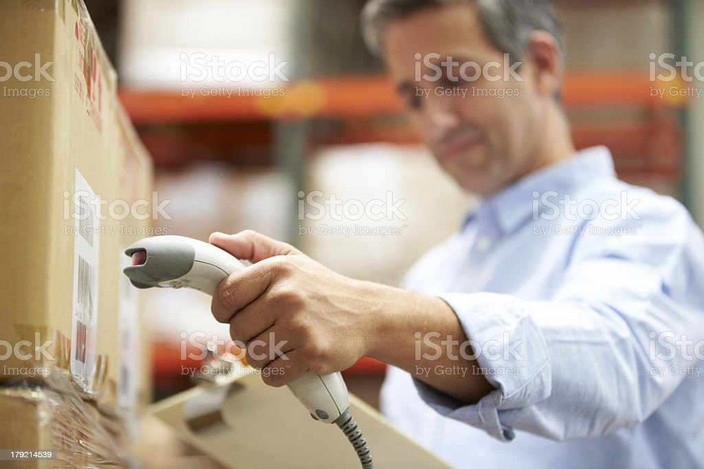 Employee scans a package in a warehouse stock photo