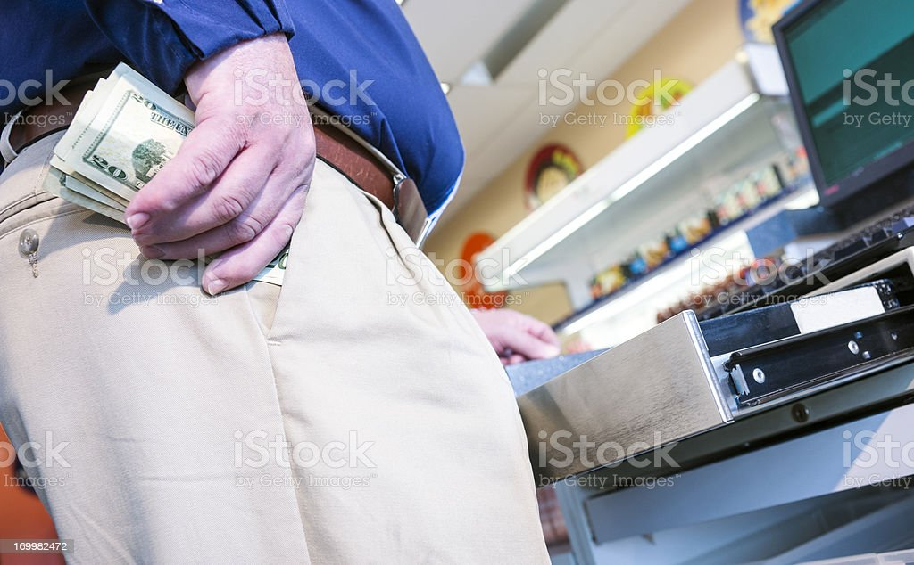 Employee stealing money from the cash register stock photo