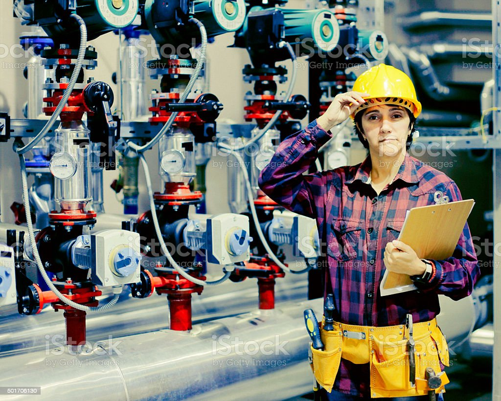 Employee take note in boiler room stock photo