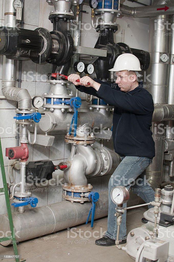employee tightens the screw stock photo