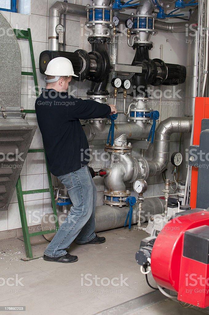employee tightens the screw royalty-free stock photo