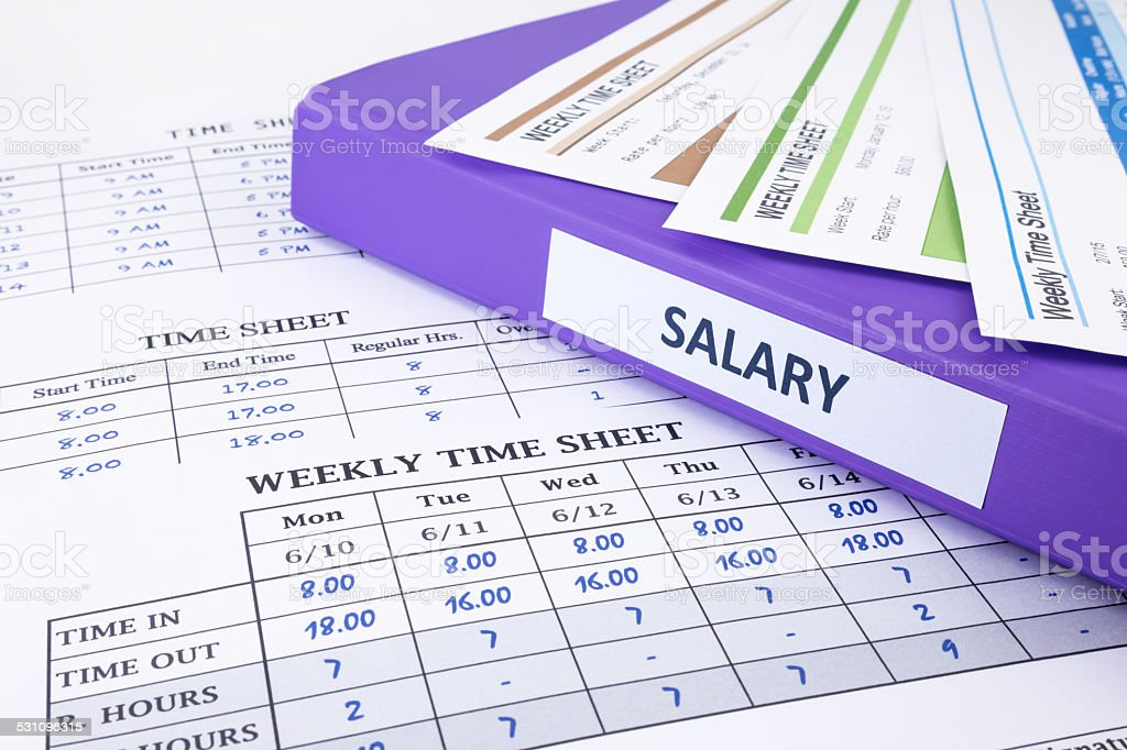 Employee time sheet and salary binder stock photo