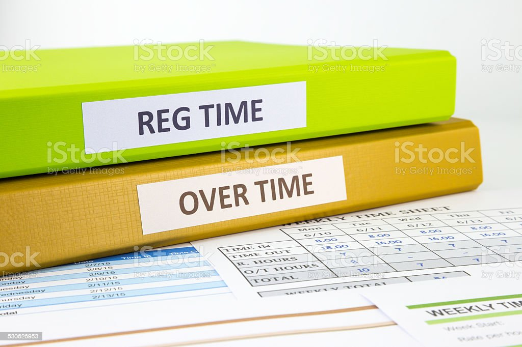 Employee time sheets stock photo