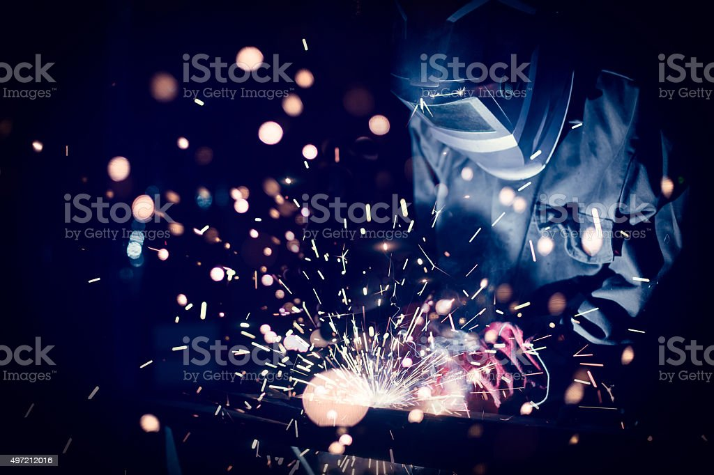 Employee welding steel stock photo
