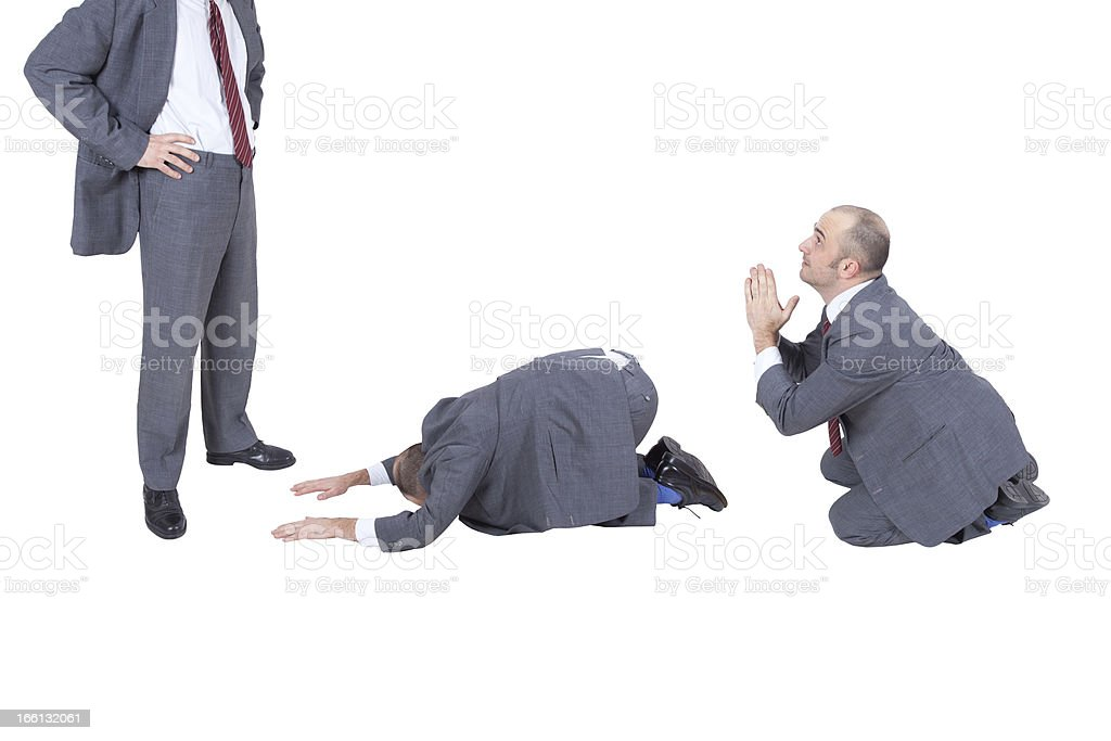 employees begging their boss royalty-free stock photo