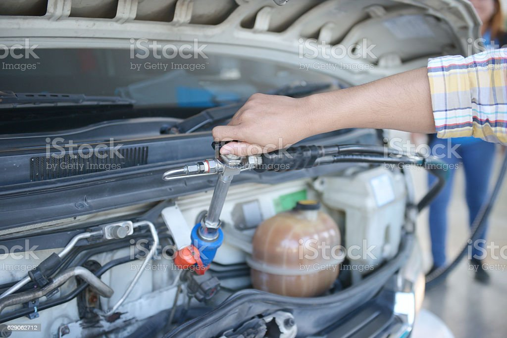 Employees controlled the fuel pump at the gas station. stock photo