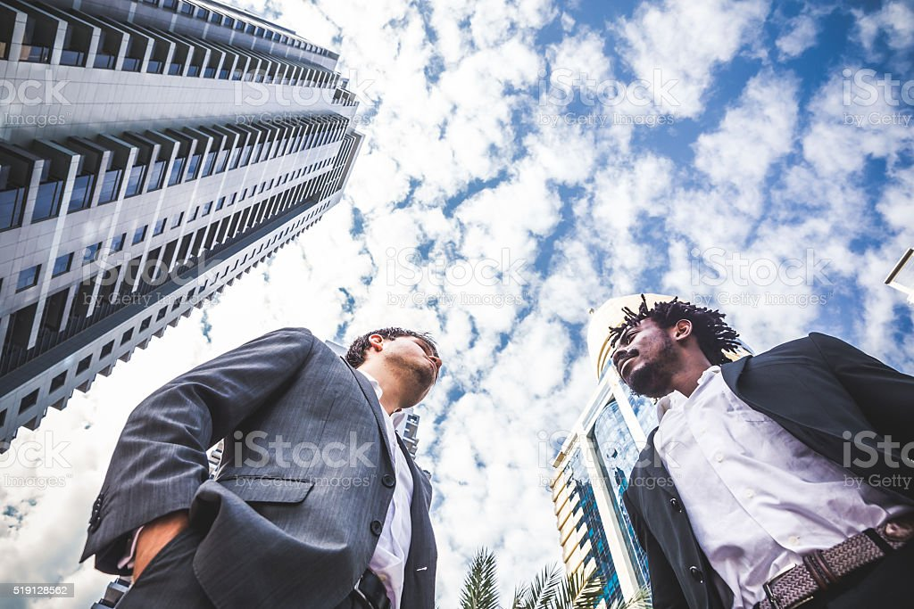 Employees Discussing Business Outside of their office. stock photo