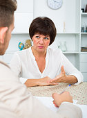 Employer discusses with elderly woman