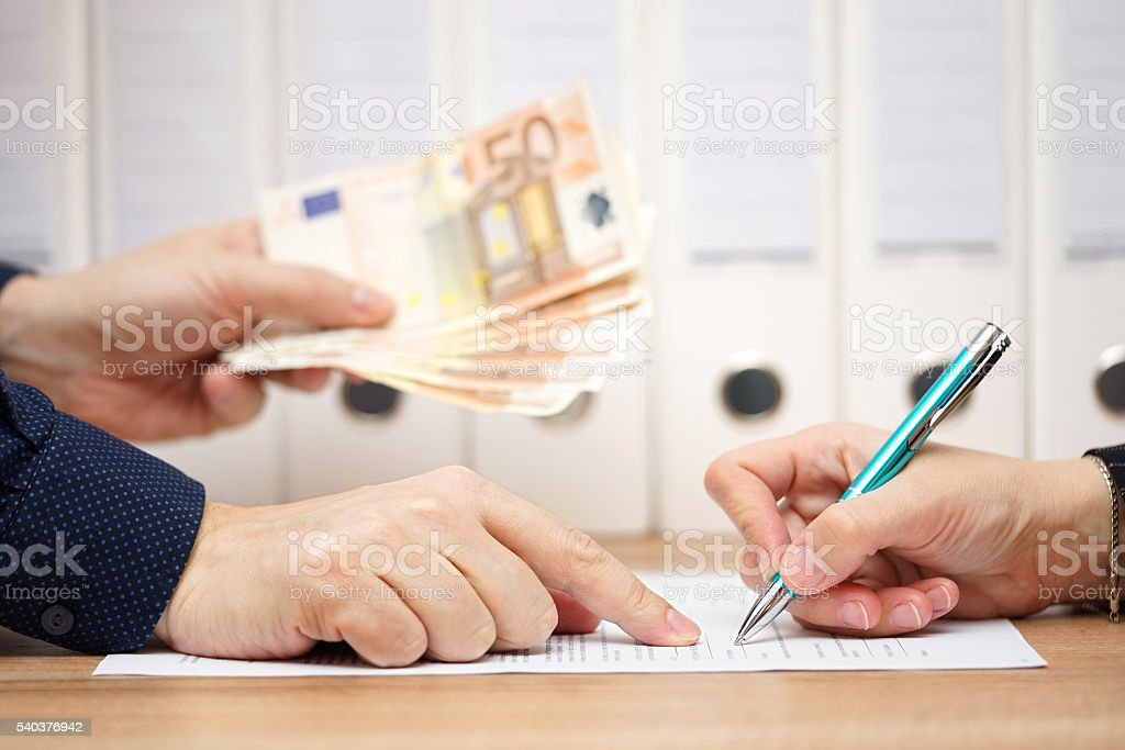 employer or businessman showing where to sign  in exchange stock photo