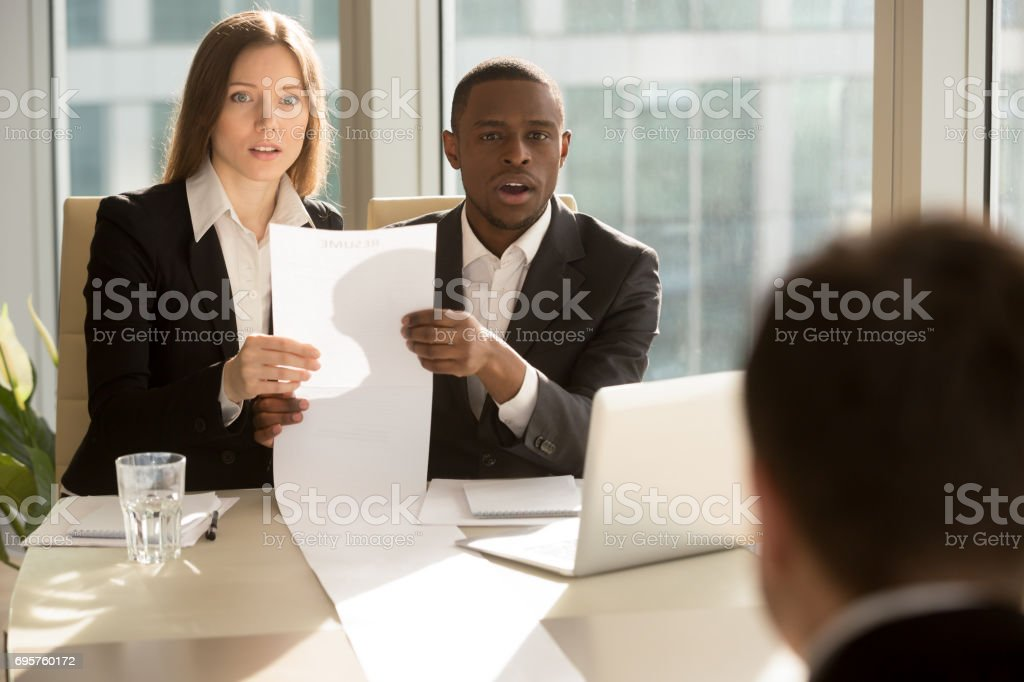 Employers recruiters shocked by great career achievements of job applicant stock photo