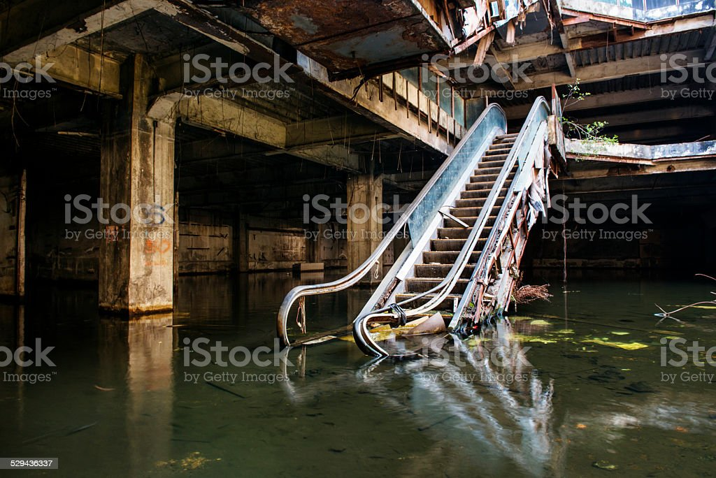 Empty Abandoned Flooded Building Interior Escalator stock photo