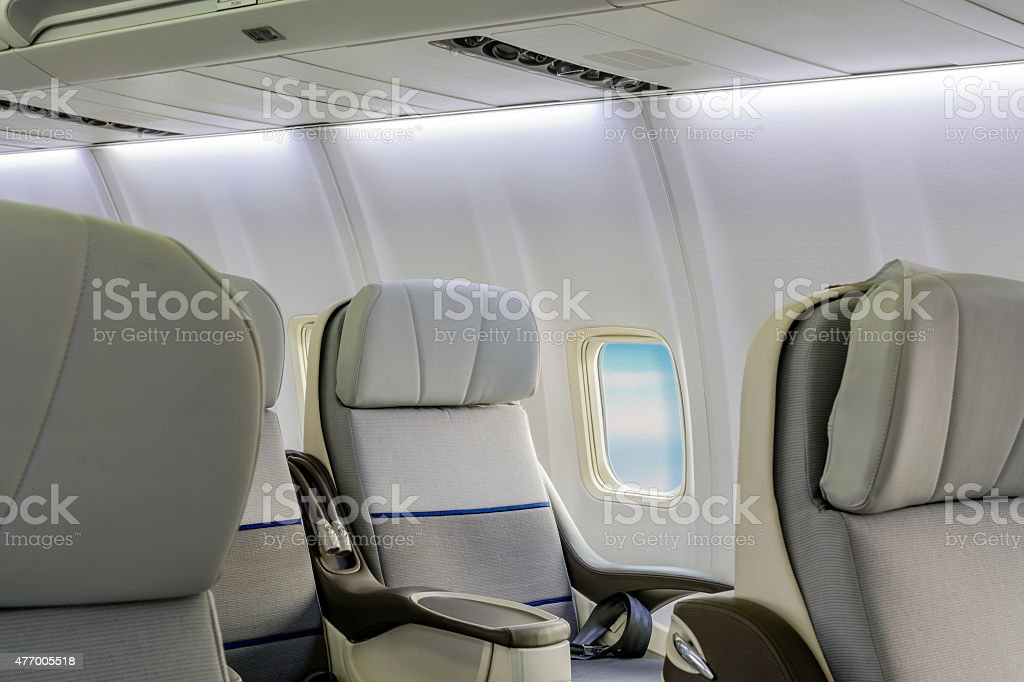 Empty aircraft seats and windows stock photo