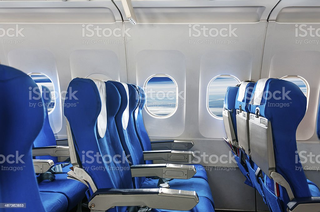 Empty aircraft seats and windows. stock photo