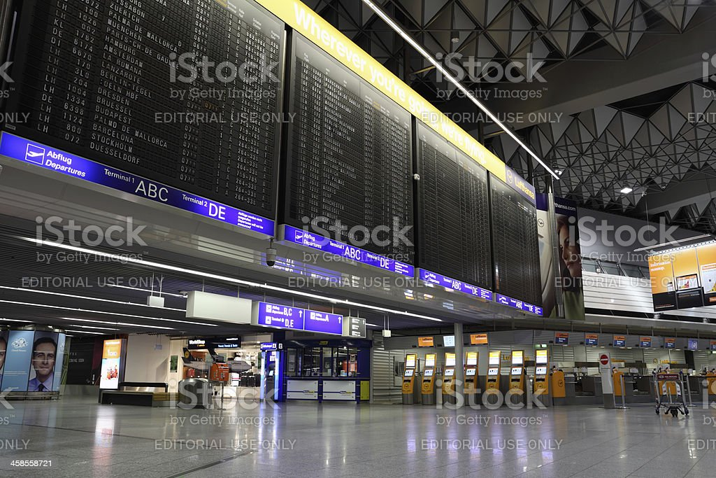 Empty airport terminal at night stock photo