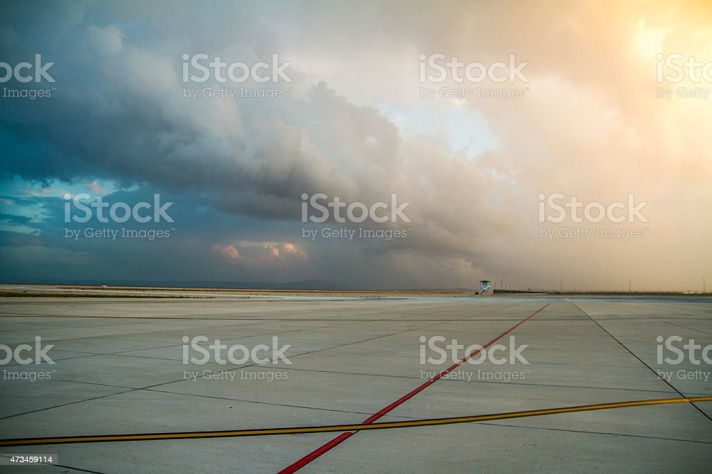 Empty airport with awesome sky stock photo