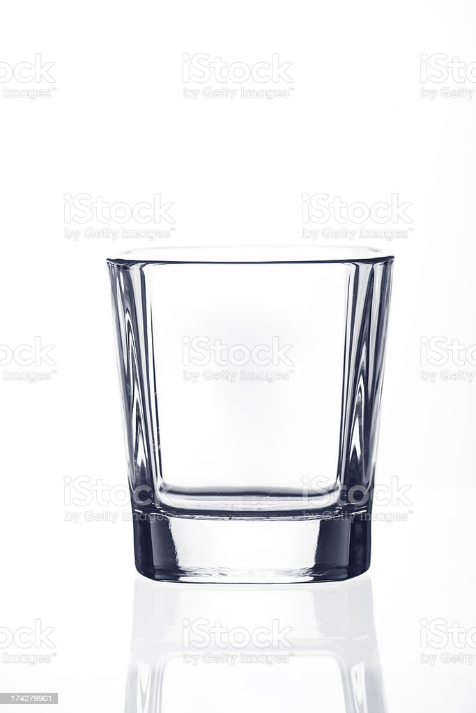 Empty alcohol glass, isolated on white royalty-free stock photo