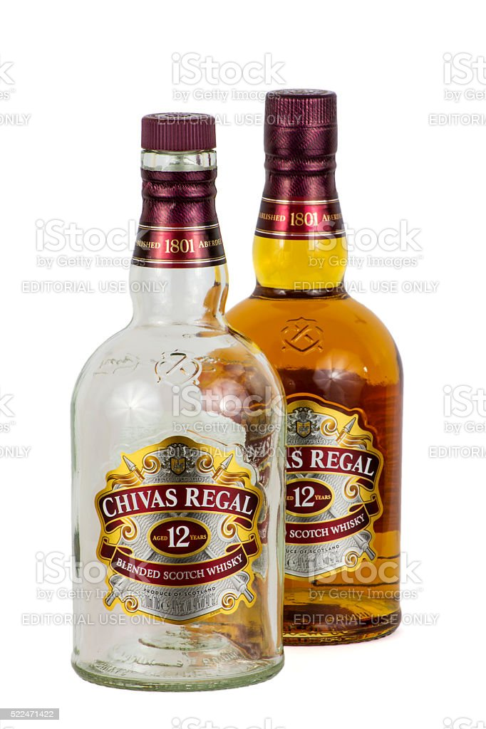 Empty and full bottles of Chivas Regal whisky stock photo