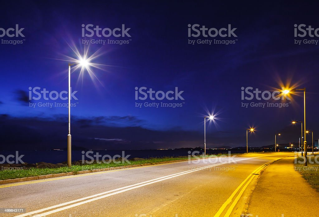 Empty asphalt road at night stock photo