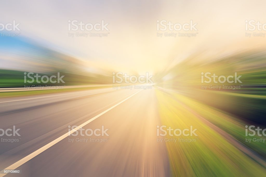 Empty asphalt road in motion blur and sunlight stock photo