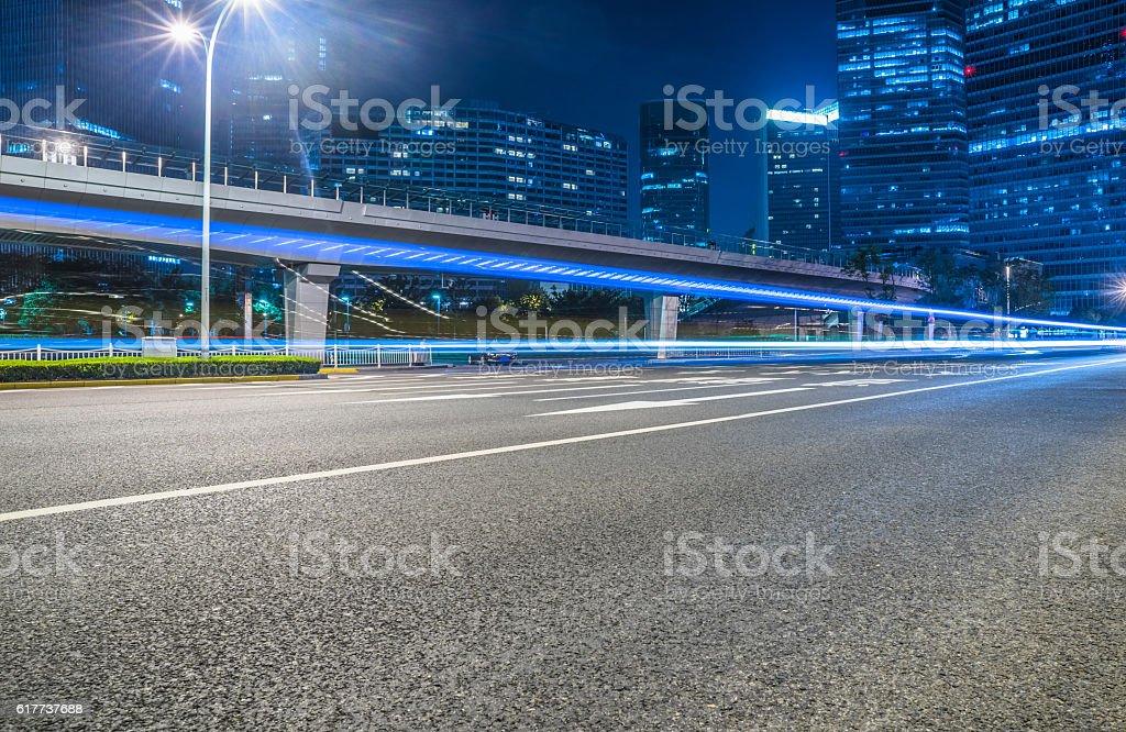 empty asphalt road through modern city. stock photo