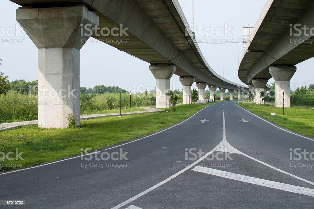 Empty asphalt road under the new expressway line. stock photo