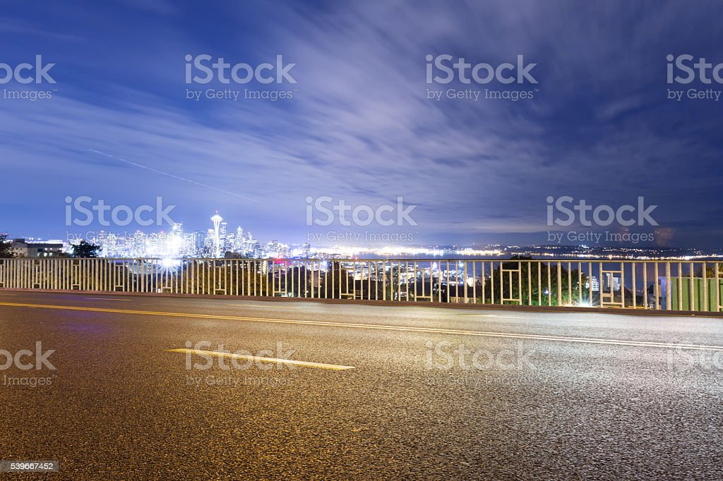empty asphalt road with cityscape and skyline of seattle stock photo