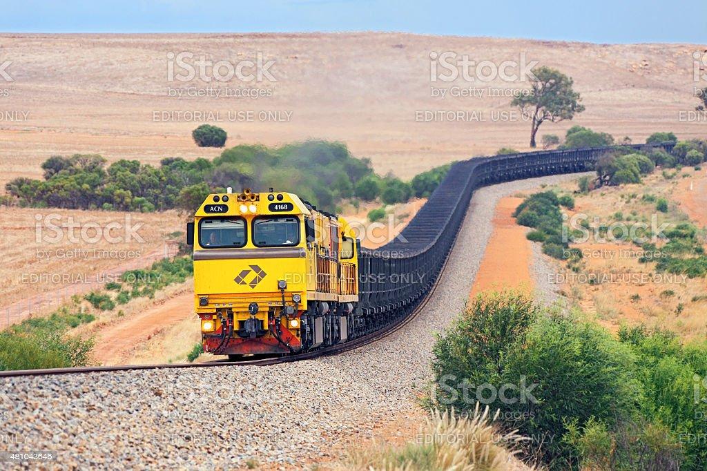 Empty Aurizon/Karara magnetite iron ore train in hills stock photo