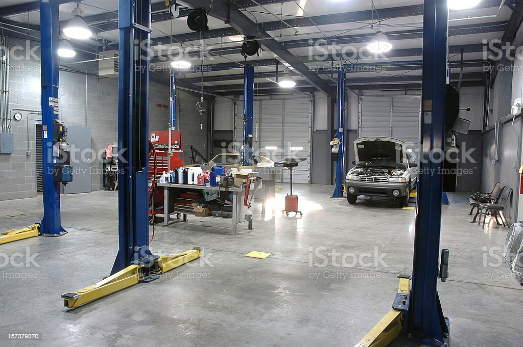 Empty Auto Repair Shop For Car Maintenance royalty-free stock photo