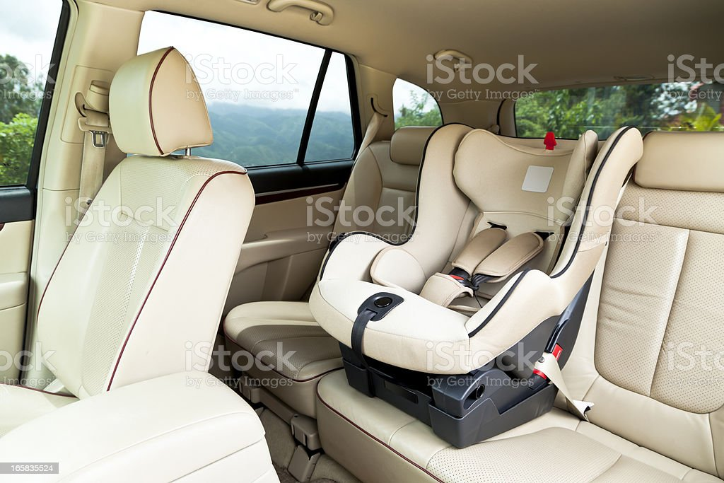 Empty baby car seat inside car stock photo