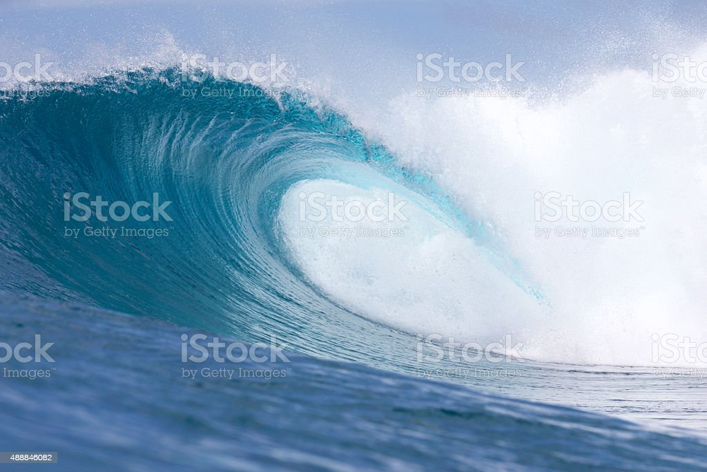 Empty barreling reef wave in the tropics stock photo
