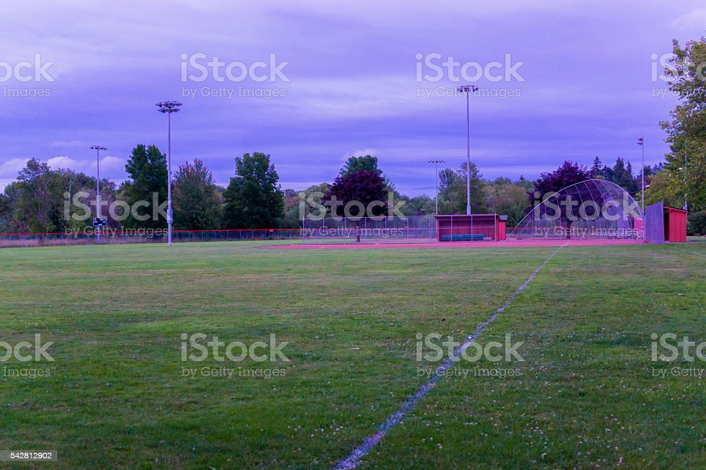 Empty baseball field on a summer night stock photo