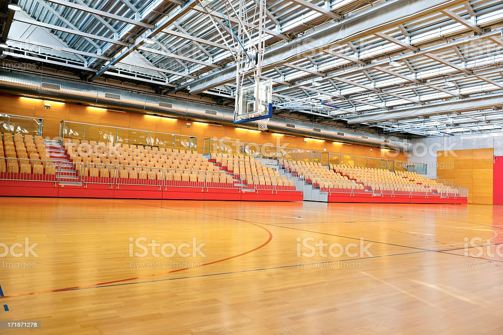 Empty Basketball School Gymnasium with Metal Roof stock photo