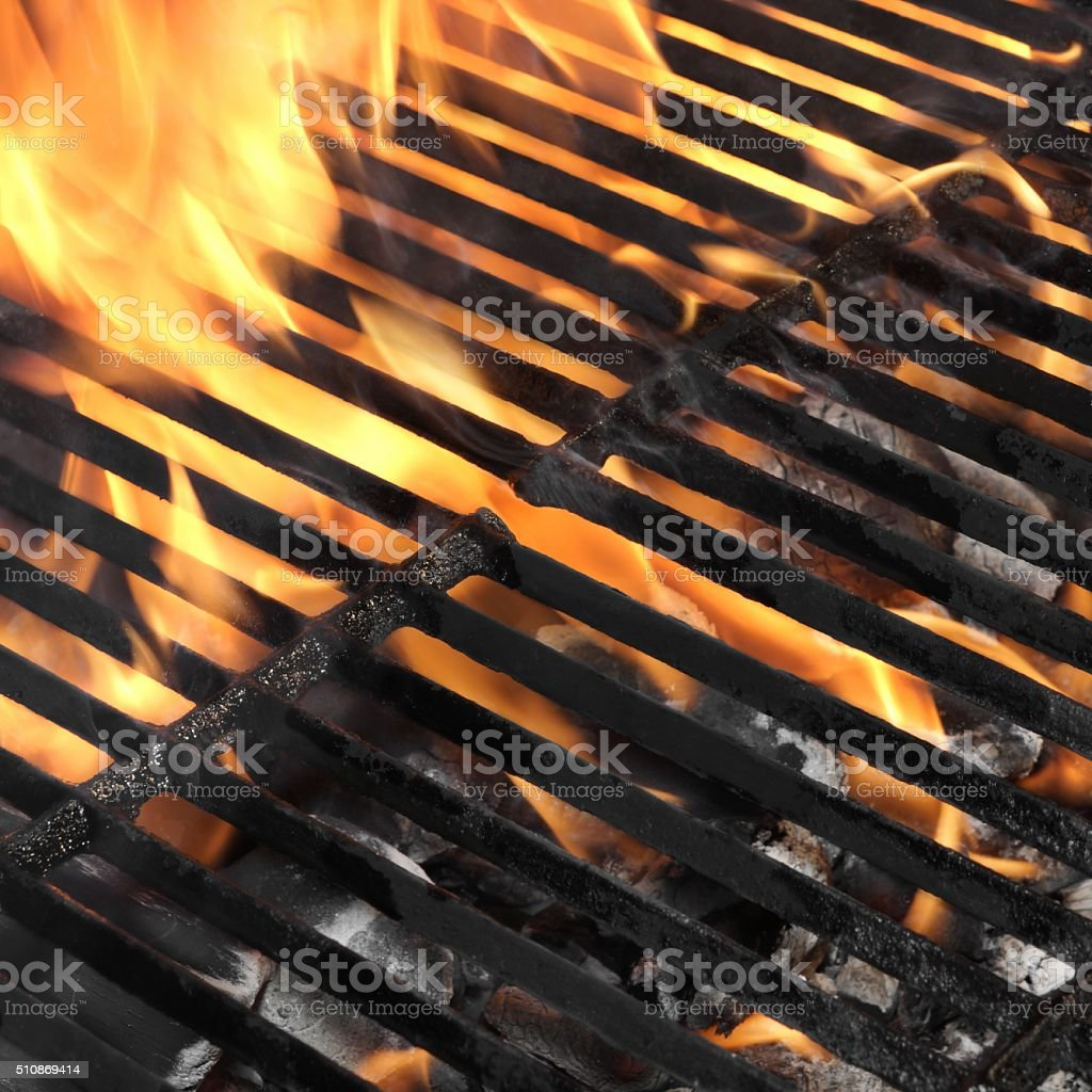 Empty BBQ Fire Grill And Burning Charcoal With Bright Flames. stock photo