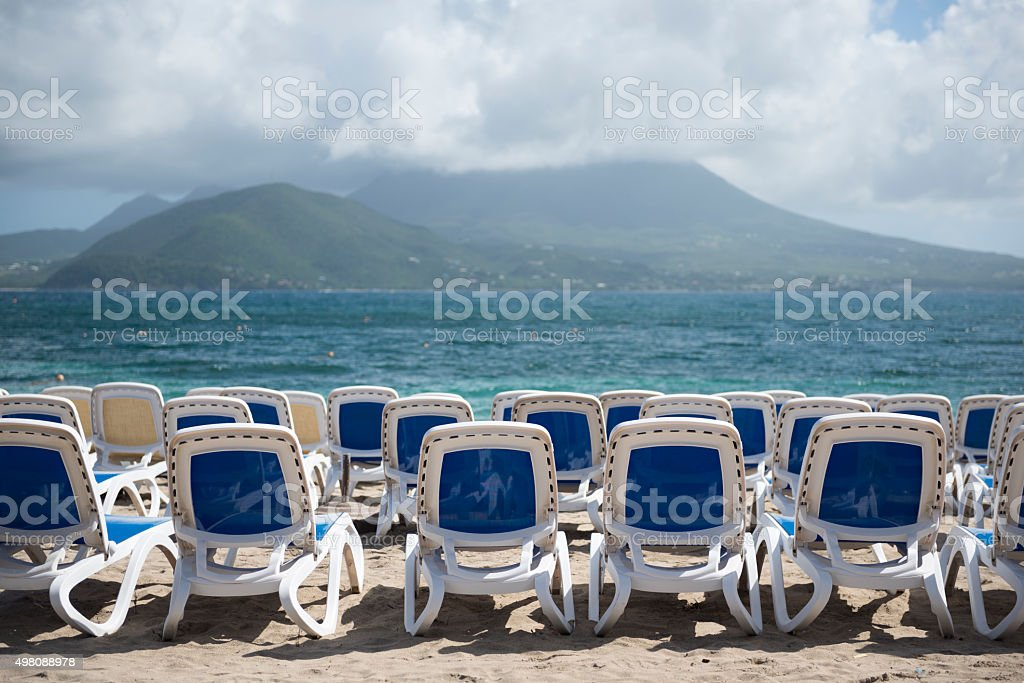 Empty beach chairs and beautiful view on St. Kitts. stock photo