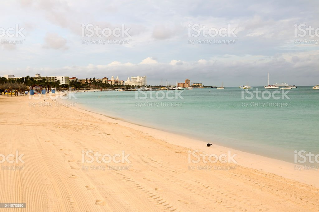 Empty beach in Aruba, early morning before vacationers arrive stock photo