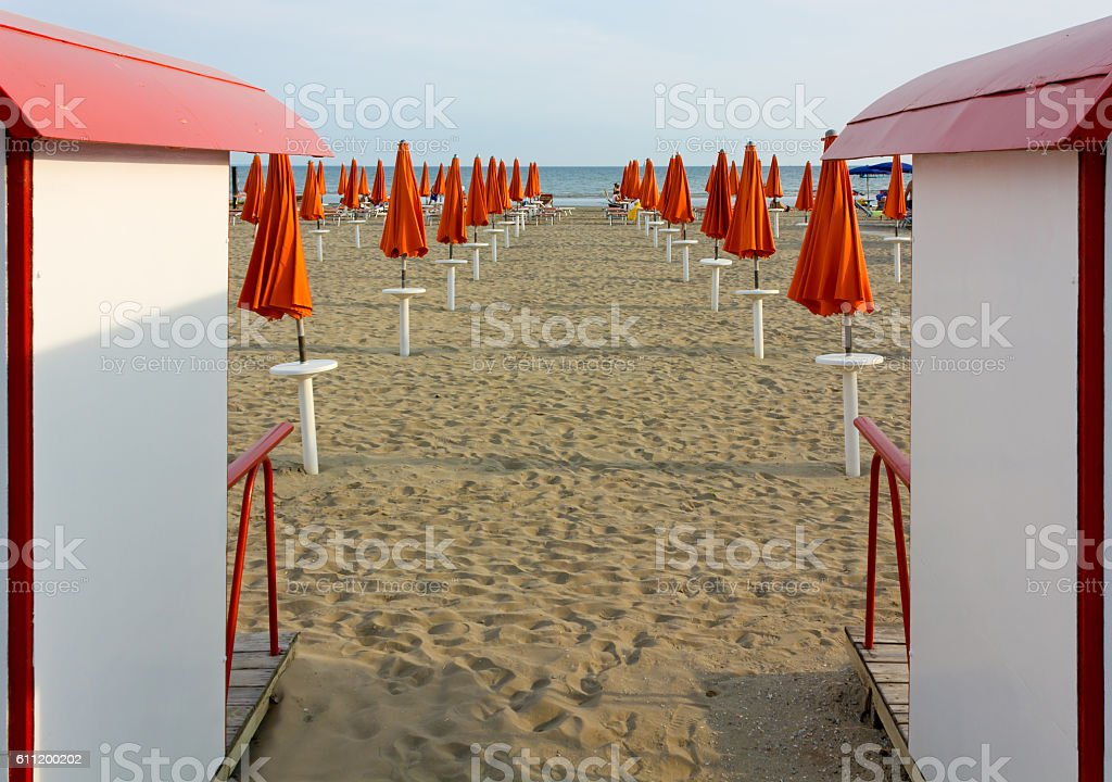 Empty Beach with Closed Beach Umbrellas stock photo