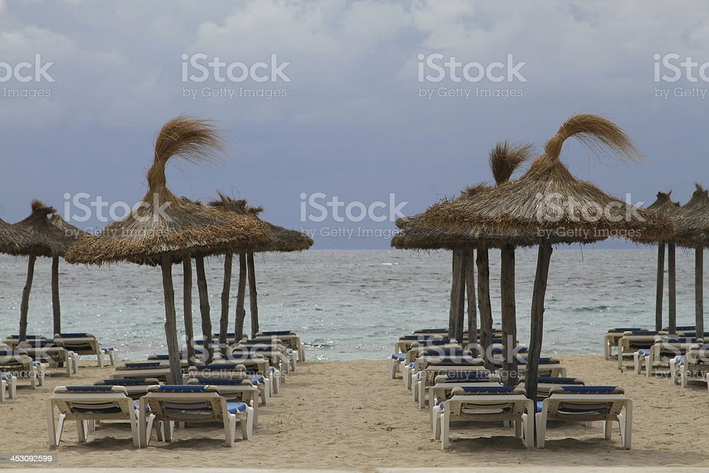 empty beach with clouds stock photo