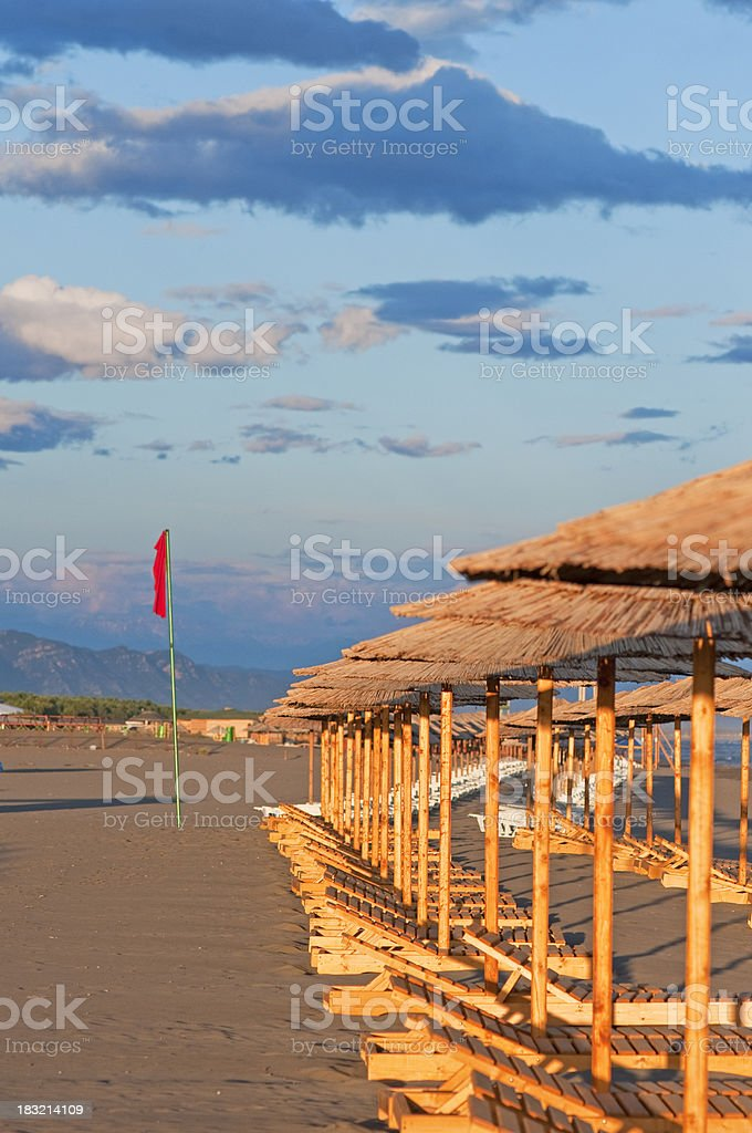 Empty beach with red flag stock photo