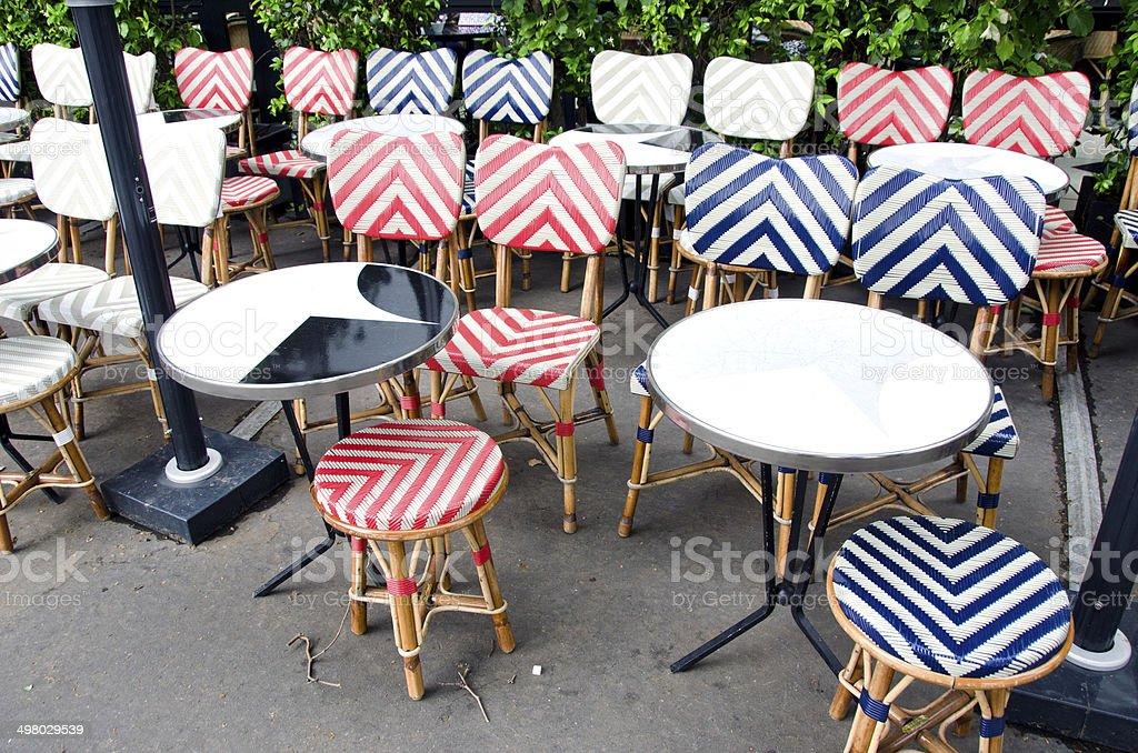 empty beautiful street cafe restaurant furniture in Paris stock photo