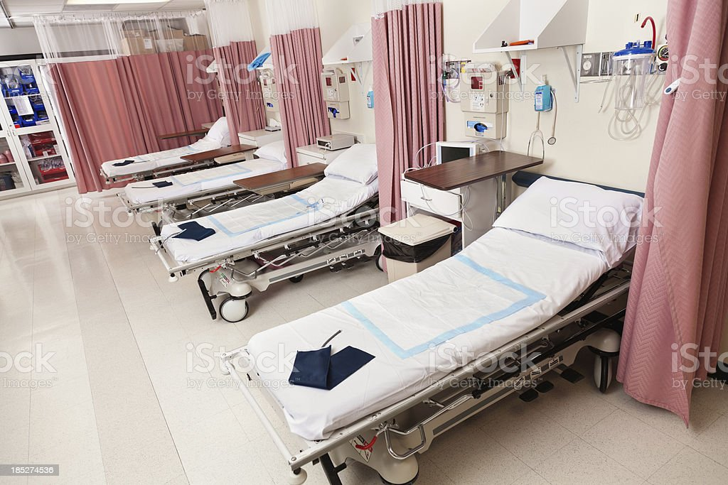Empty beds in a hospital or surgical center recovery room stock photo