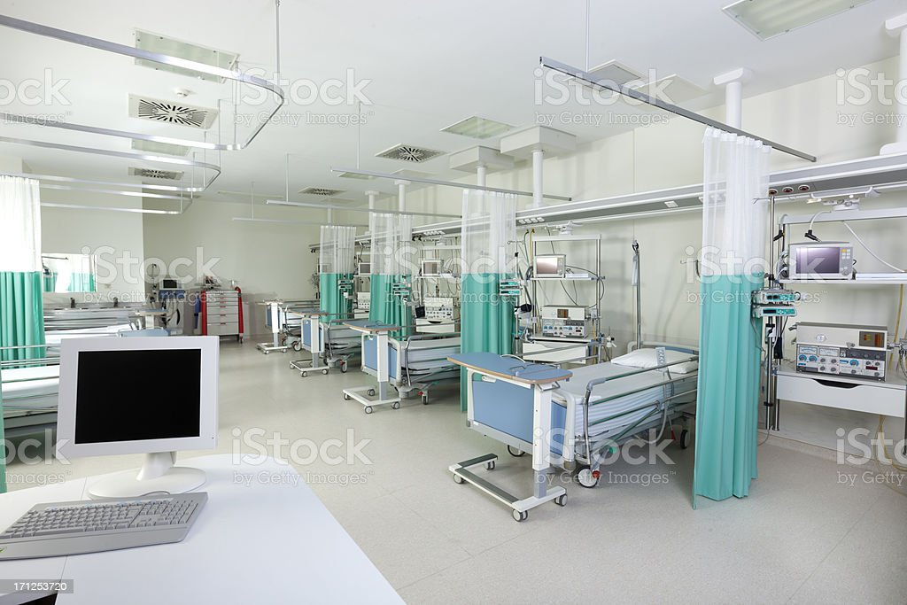 Empty beds in a hospital or surgical recovery room stock photo