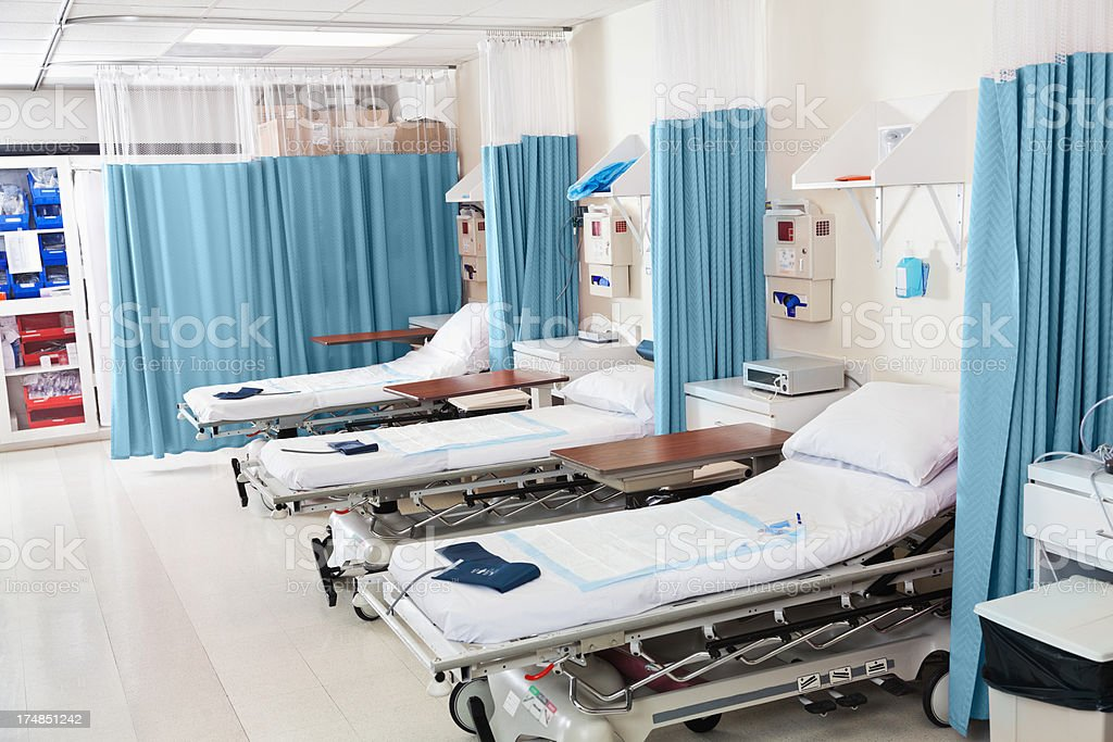 Empty beds ready for patients in hospital surgery recovery room stock photo