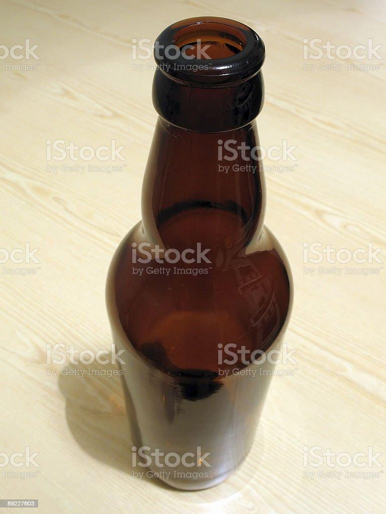 Empty beer bottle stock photo