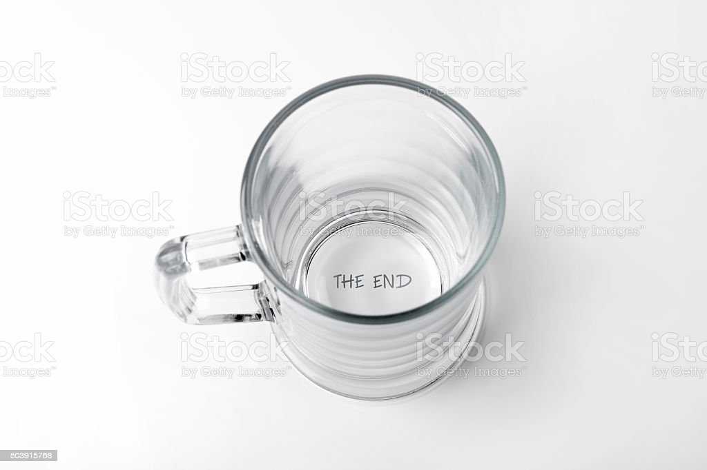 empty beer cup with 'the end' text on the bottom stock photo
