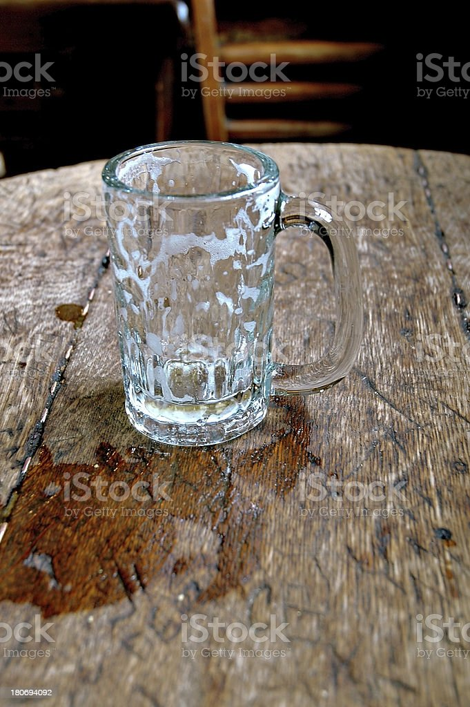 Empty beer mug on the  old bar table. stock photo