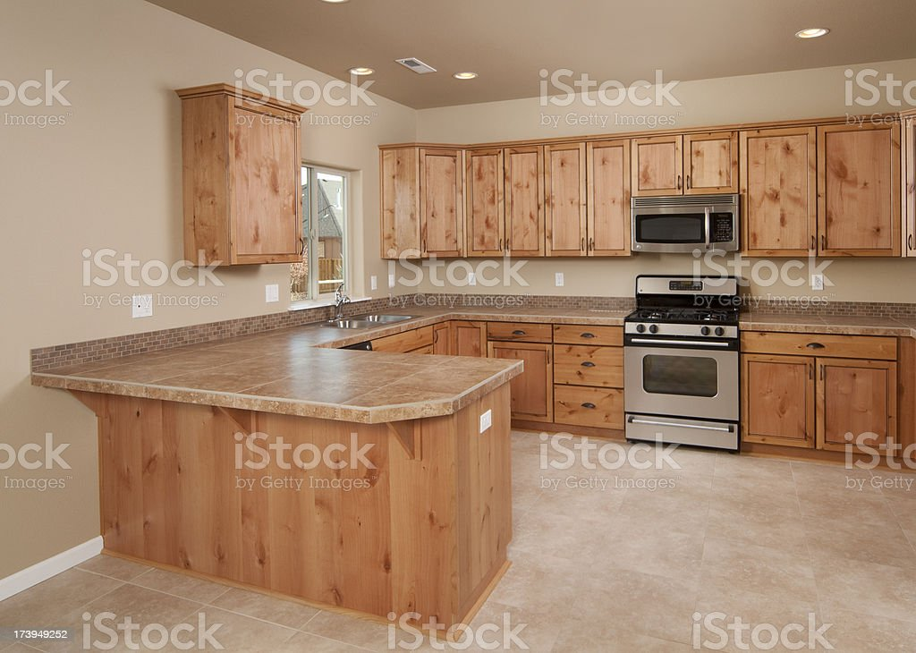 Empty beige colored kitchen royalty-free stock photo