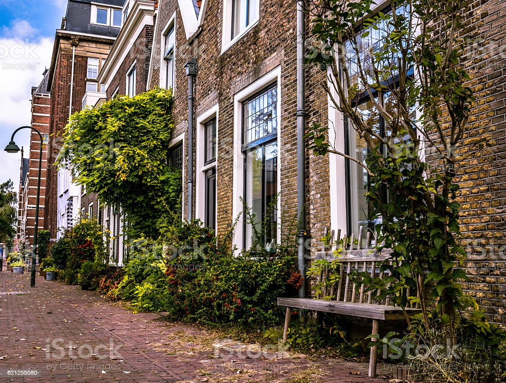 Empty bench against a house, the Netherlands stock photo