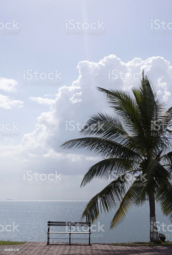 Empty Bench facing a peaceful, tranquil view across the Ocean stock photo