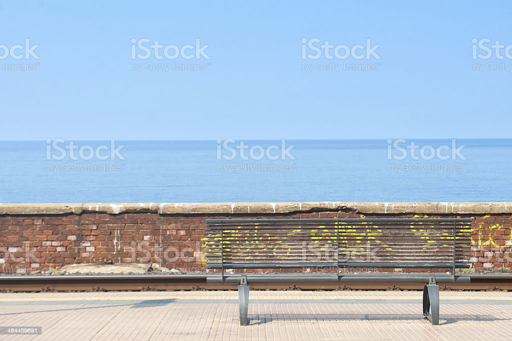 Empty bench in a station royalty-free stock photo